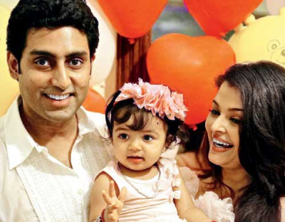 Image result for abhishek bachchan with wife and daughter